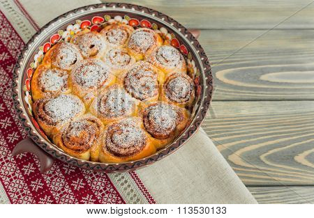 delicious cinnamon rolls on wooden background.
