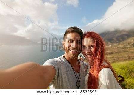 Cheerful Young Couple Taking A Selfie