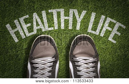Top View of Sneakers on the grass with the text: Healthy Life
