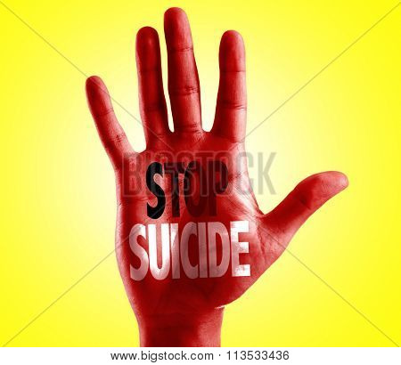 Stop Suicide written on hand with yellow background