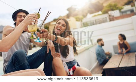 Friends Having A Cocktail Party On Roof