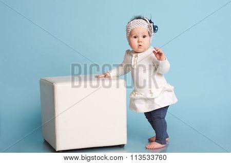 Child girl over blue