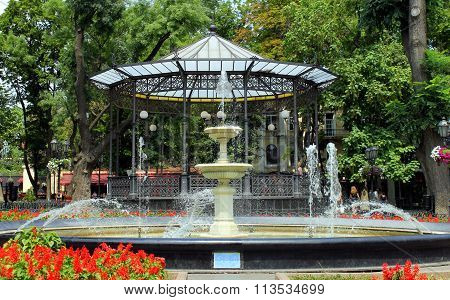 Old fountain and alcove  in the  garden.