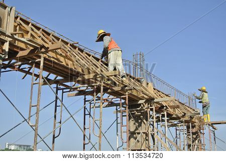 Construction Workers Installing Beam Formwork and the reinforcement bar