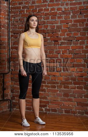 Sport Brunette On Brick Wall Background