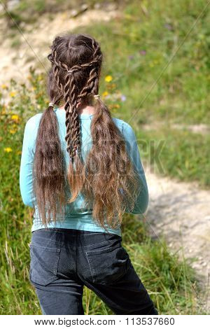 Girl with renaissance hairstyle of pigtails and rope braids
