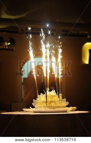 Celebration! Flaming Wedding Cake Against Black Background