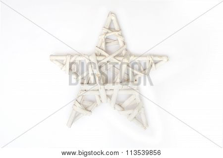Wicker Christmas Star On A White Background