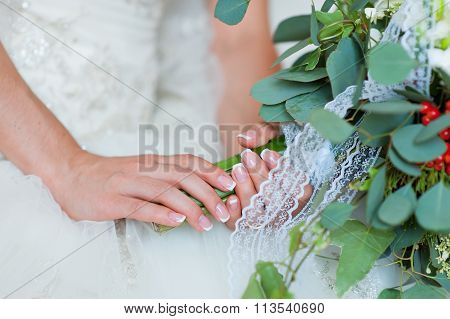 Bride's Hand With A Ring On A Bouquet Closeup
