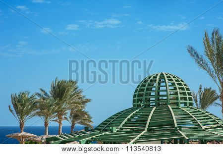 Gazebo Wooden Ceiling On Blue Sky Background