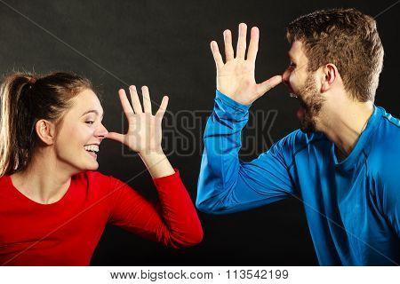 Happy Couple Mocking Having Fun Playing The Fool.