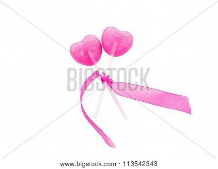 two lollipop in heart shape isolated on white background