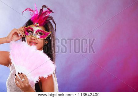 Woman With Carnival Mask Holds Fan