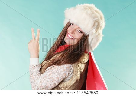 Happy Woman With Bag Shopping. Winter Fashion.