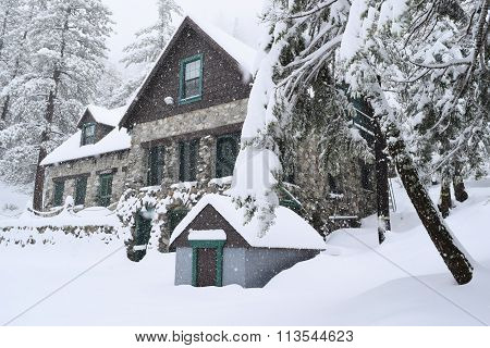 January 7, 2015 in Mt Baldy, CA:  Historic Harwood Lodge built in 1930 which is owned by the Sierra Club and where members can stay overnight taken during a snow storm in Mt Baldy, CA