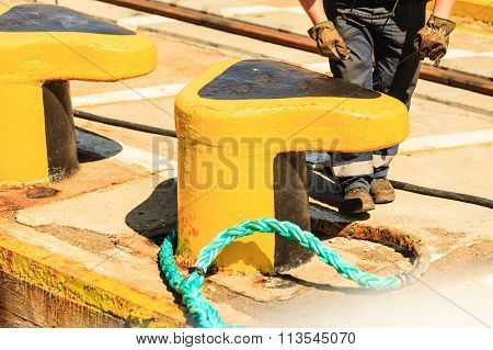 Yellow Mooring Bollard With Blue Rope