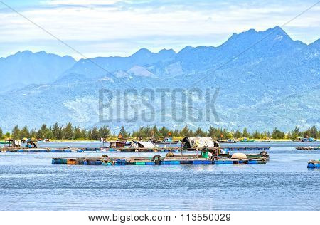 Village fishermen raft on the bay