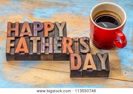 happy father's day in vintage wood letterpress printing blocks with a cup of coffee
