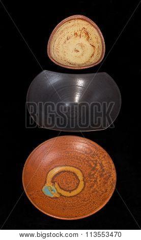 Ceramic Dishes Against Black