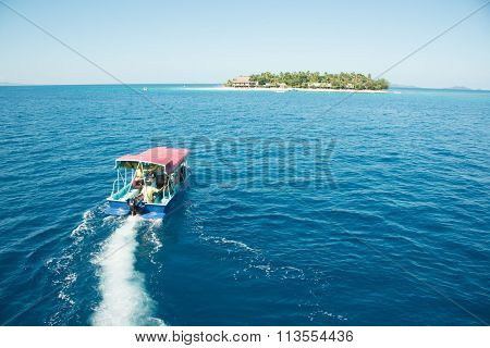 Boat heading to island