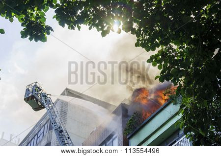 Fire Fighter Is Fighting Against The Fire Disaster