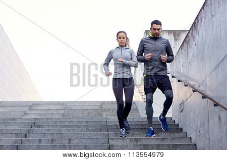 couple walking downstairs on stadium