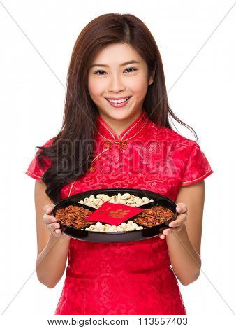 Asian woman hold with snack tray for chinese new year