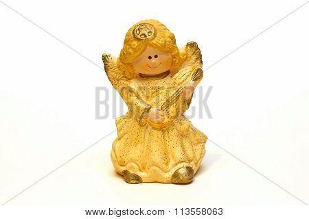 Ceramic Angel Figurine Yellow On A White Background