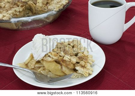 Apple pie with whipped cream on white plate with cup coffee