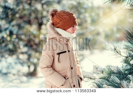 boy in a hat on the snow