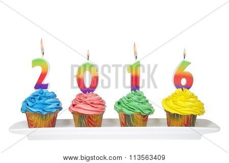 Colorful CupCakes with number candles 2016 on a rectangular plate Isolated on white background