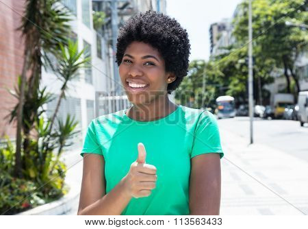 Beautiful African Woman In A Green Shirt In The City