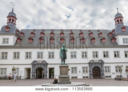 Town Hall Of Koblenz, Germany With Statue Of Johannes-muller-denkmal In The Foreground