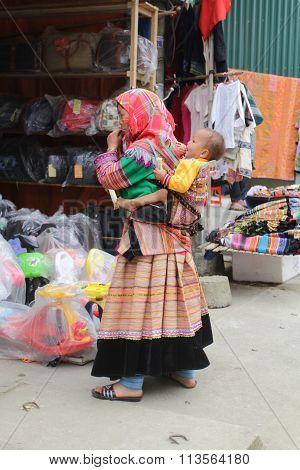 SAPA, VIETNAM - FEBRUARY 08, 2015: Hmong women at Bac Ha market in Northern Vietnam.