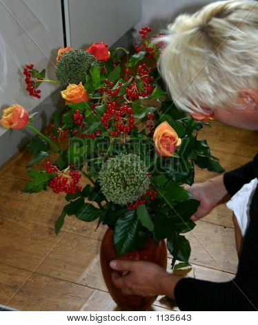 Putting Flowers In Vase