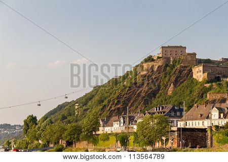 Ehrenbreitstein Fortress Bathed In Afternoon Light And Cableway Connecting It To Koblenz, Germany