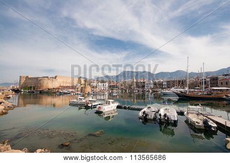 Scenic View Of The Old Harbour Of  Kyrenia, Island Of Cyprus, With The Medieval Castle In The Backgr