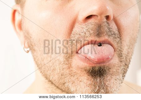 Man showing off his tongue ring