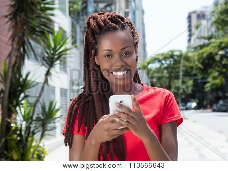 African Woman With Dreadlocks Sending Message In The City