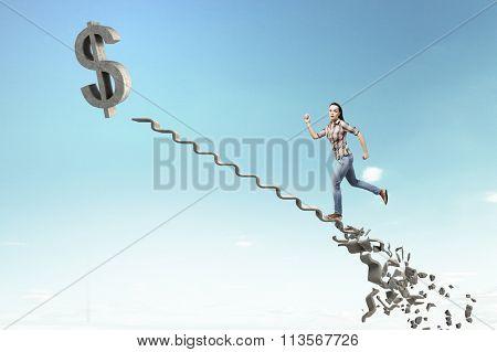 Woman climbing stone ladder