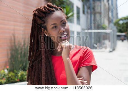 Thinking African Woman With Dreadlocks In The City