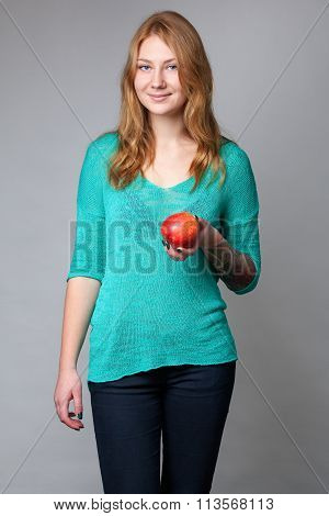 Portrait Of A Young Ginger Lady In Turquoise Blouse With An Apple.portrait Of A Young Ginger Lady In