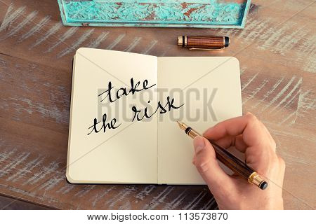 Motivational Concept With Handwritten Text Take The Risk