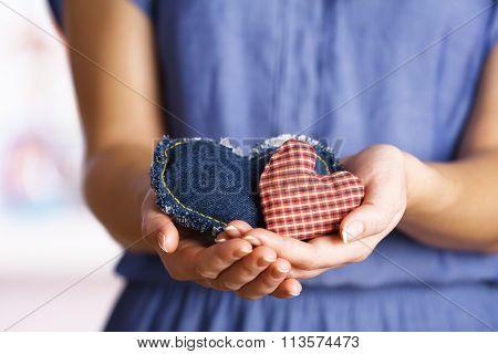 Closeup of craft hearts in female hands
