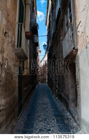 Narrow street between italian houses in old town of Tropea