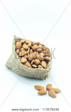 Almonds In Sack Isolated On White Background