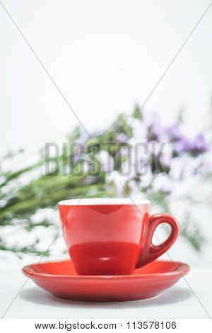 Red Cup Of Cofee And Static Flower