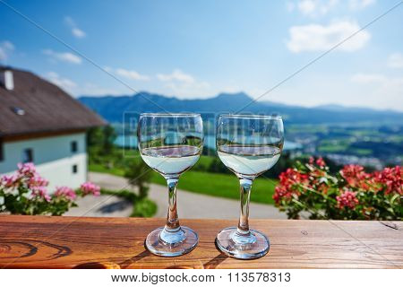Two glasses of wine in austrian mountain outdoors