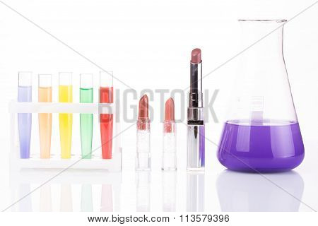 chemical test tubes and lipstick. harmful cosmetics.