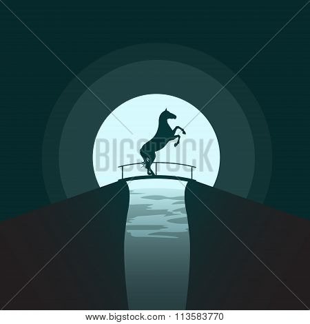 Silhouette Of A Horse Standing On Its Hind Legs On The Bridge At Night